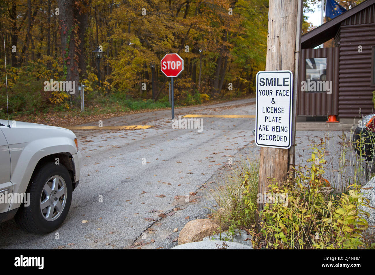A sign at the entrance to the town of Dune Acres, Indiana announces surveillance measures. - Stock Image
