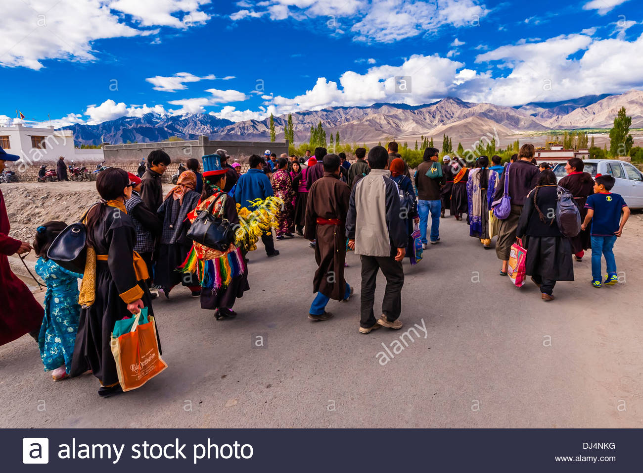 Buddhists walking to attend a teaching by His Holiness the 14th Dalai Lama at Choglamsar, Ladakh, Jammu and Kashmir Stock Photo