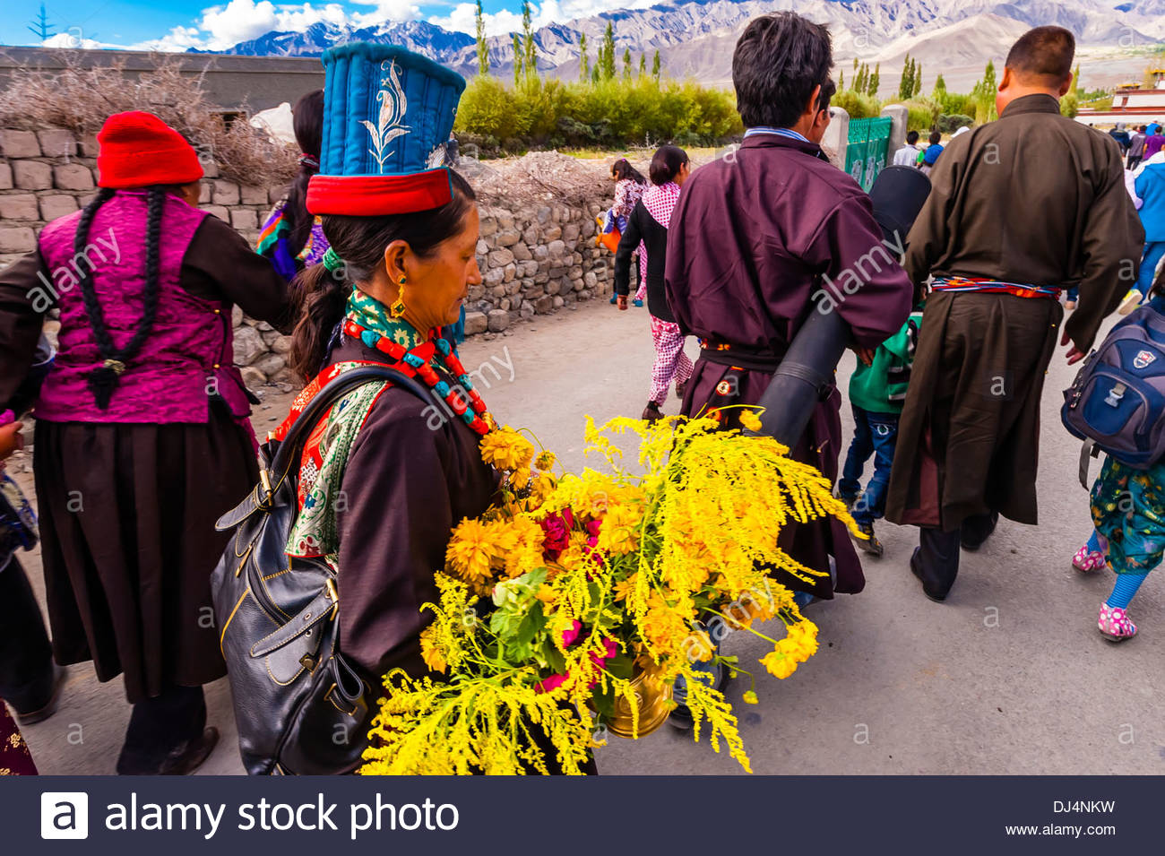 Buddhists walking to attend a teaching by His Holiness the 14th Dalai Lama at Choglamsar, Ladakh, Jammu and Kashmir State, India. - Stock Image