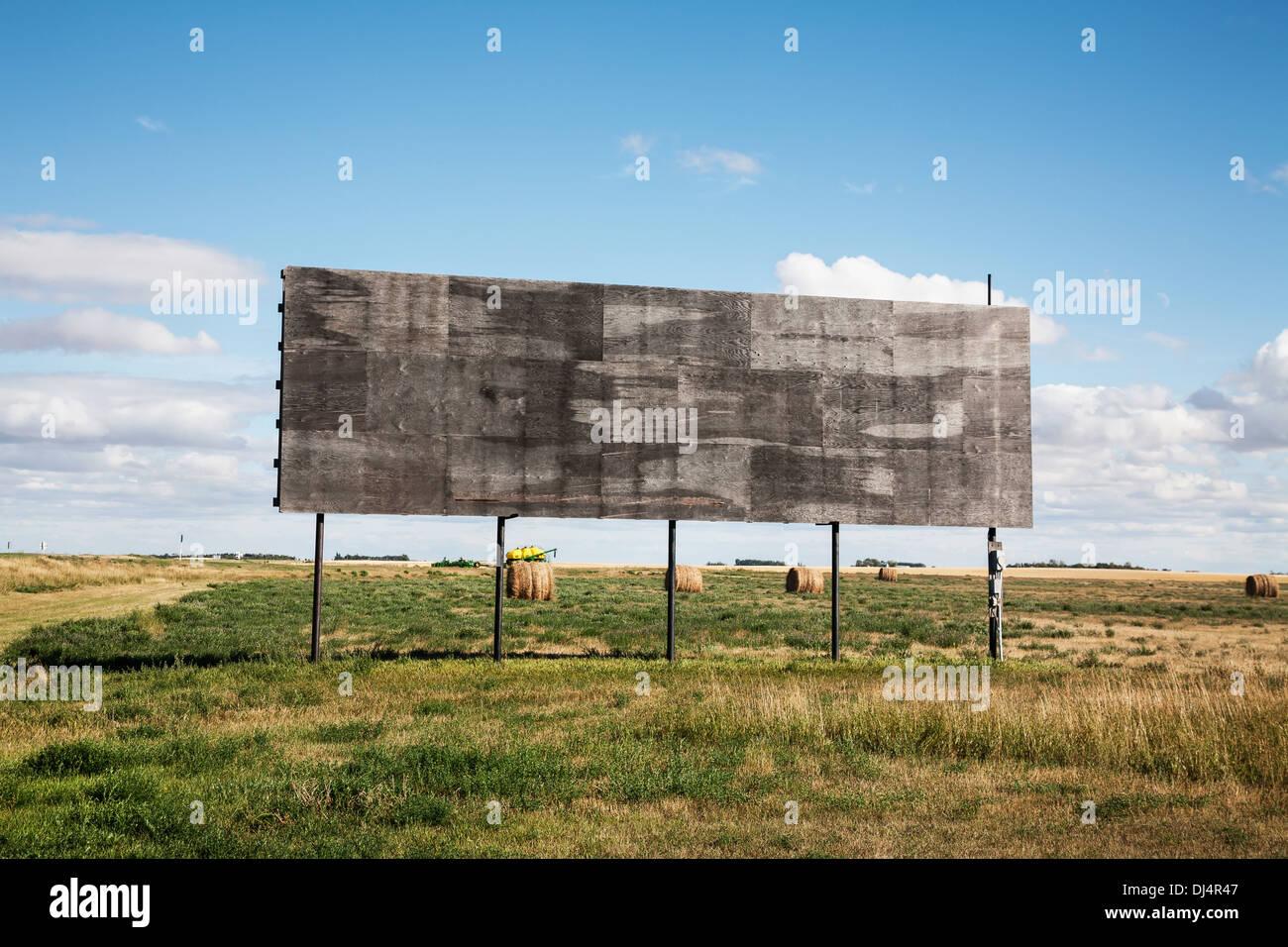An Empty Billboard Beside A Farm Field; Alberta, Canada - Stock Image