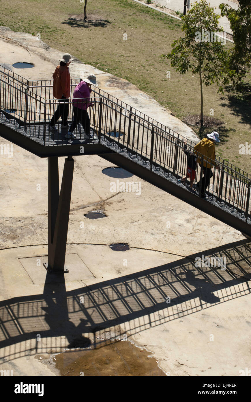 People Walking Down Outdoor Metal Staircase At Ballast Point Park, Sydney,  Australia
