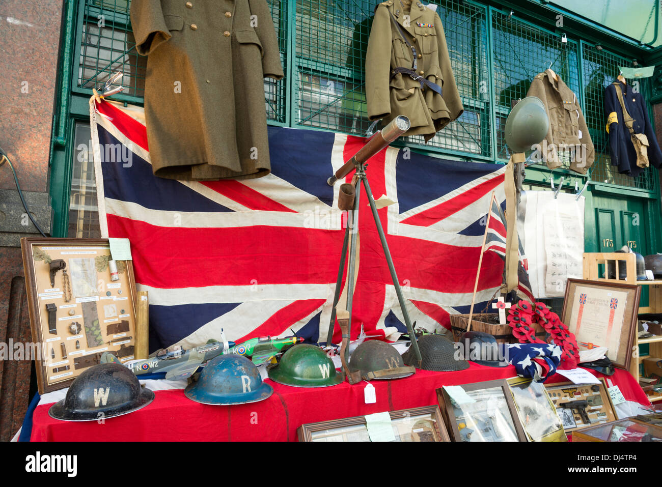 World War II memorabilia for sale on a stall at Portobello Road Market, Notting Hill, London, England, UK - Stock Image