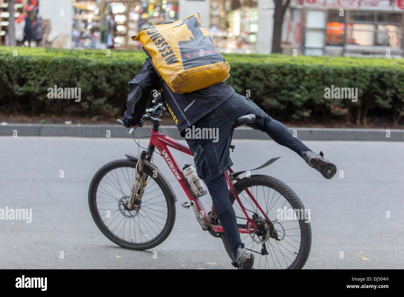 Biker, messenger, delivery service in the center of Prague, Czech Republic, Europe - Stock Image