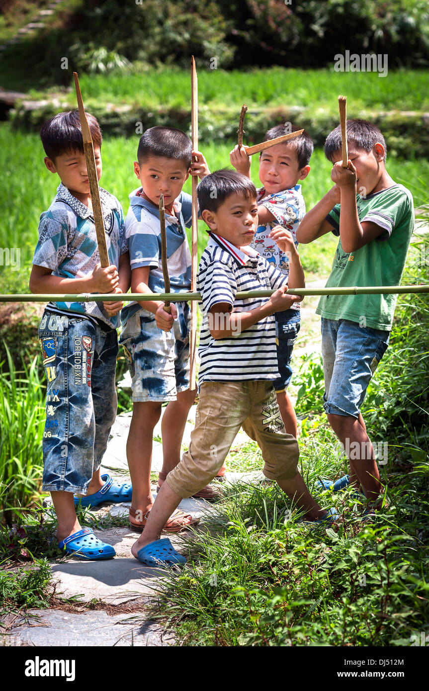 Adventurous young boys at the Longji Rice Terraces, Guangxi Province, China - Stock Image
