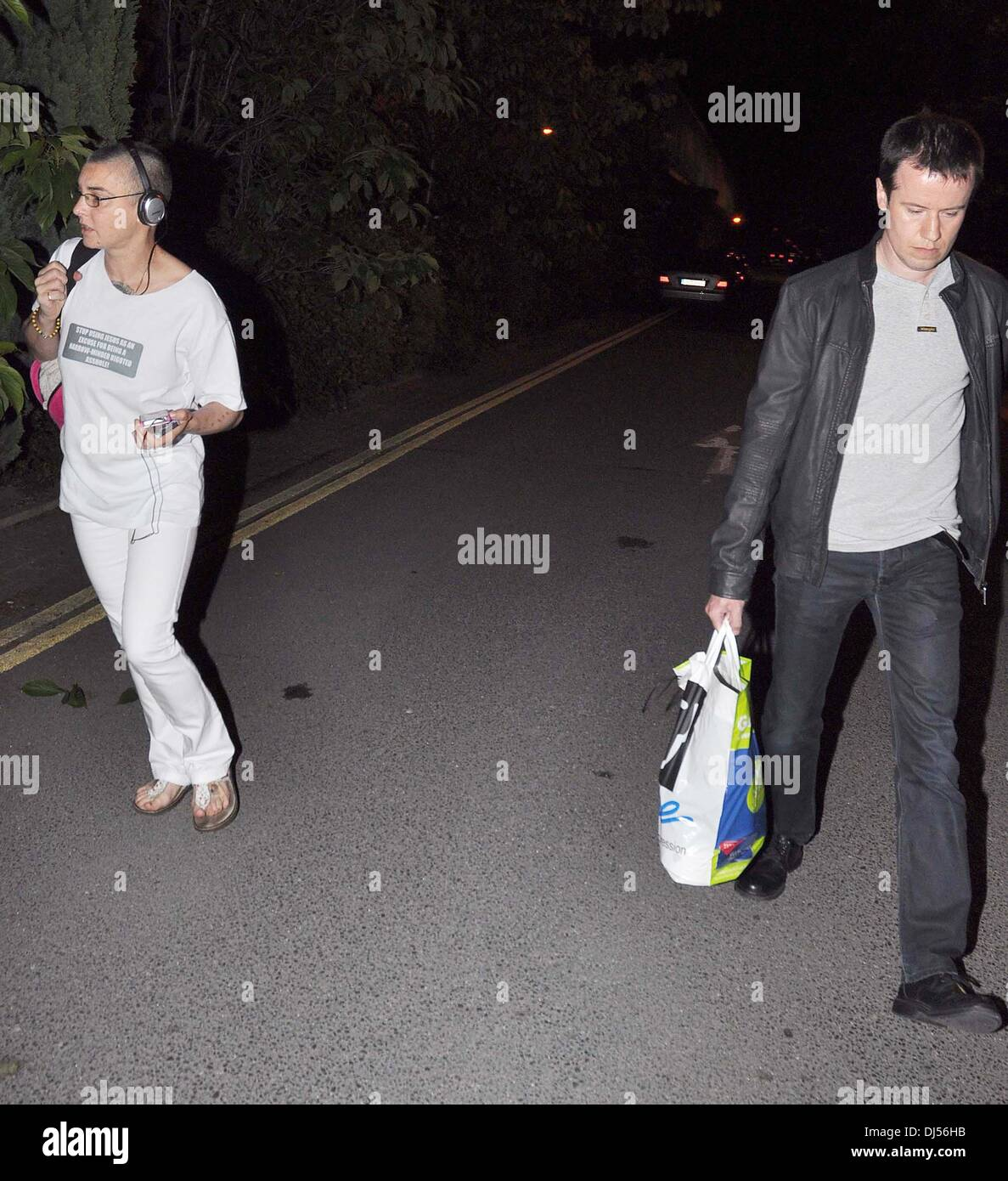Sinead O'Connor and Barry Herridge walking separately The 50th Anniversary of 'The Late Late Show' at RTE Studios Dublin, Ireland - 01.06.12 - Stock Image