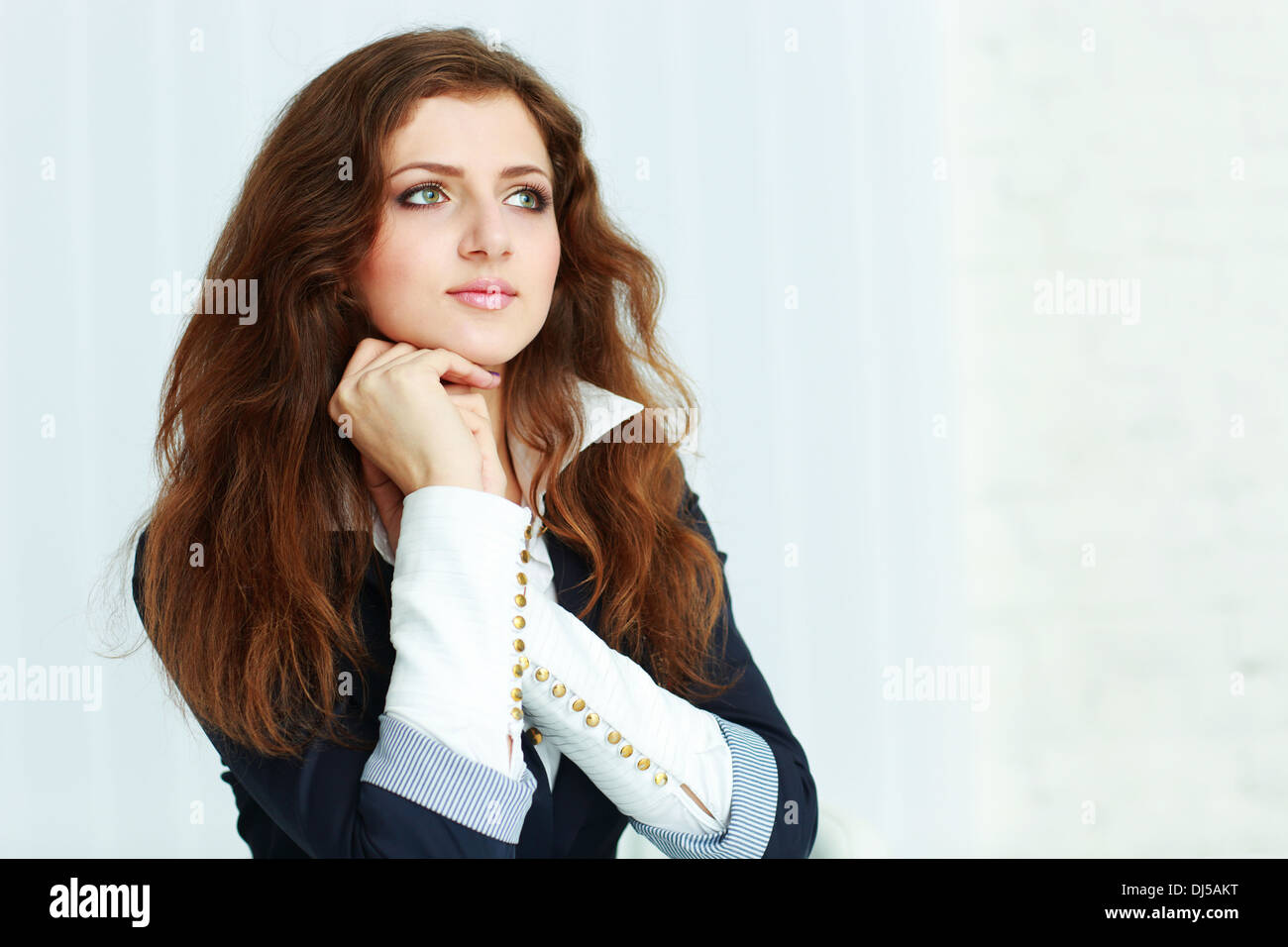 Young beautiful pensive woman looking at copyspace - Stock Image
