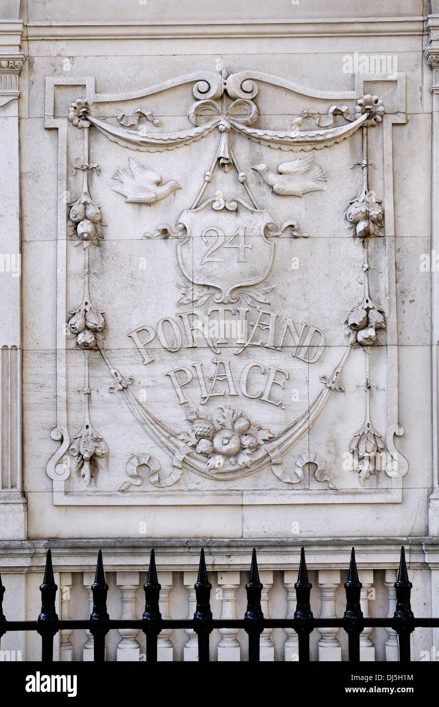 London, England, UK. 24 Portland Place. Ornate carved stone relief on the facade. - Stock Image