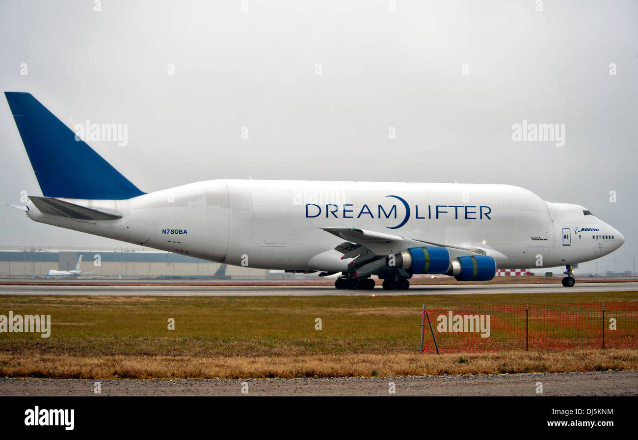 A Boeing 747 Dreamlifter taxis after landing at McConnell Air Force Base after mistakenly landing at Col. James Jabara Airport the night before November 21, 2013 in Wichita, KS. The aircraft which is the largest cargo carrier in the world mistakenly landed at a much smaller airport and despite the shorter runway was able to take off and land at the intended destination. - Stock Image