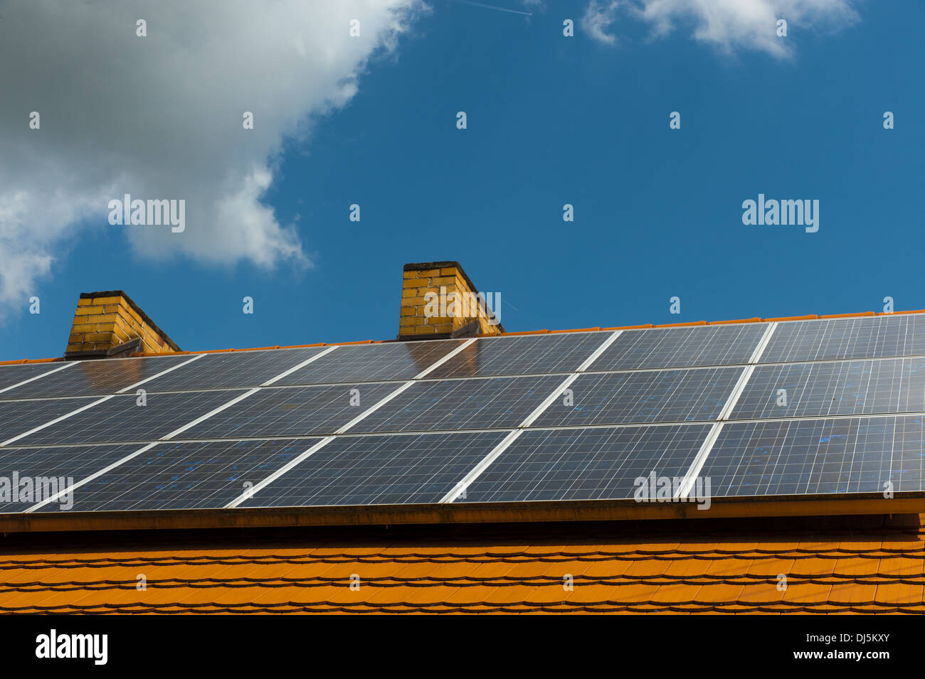 Roof of a farm house with solar panels - Stock Image