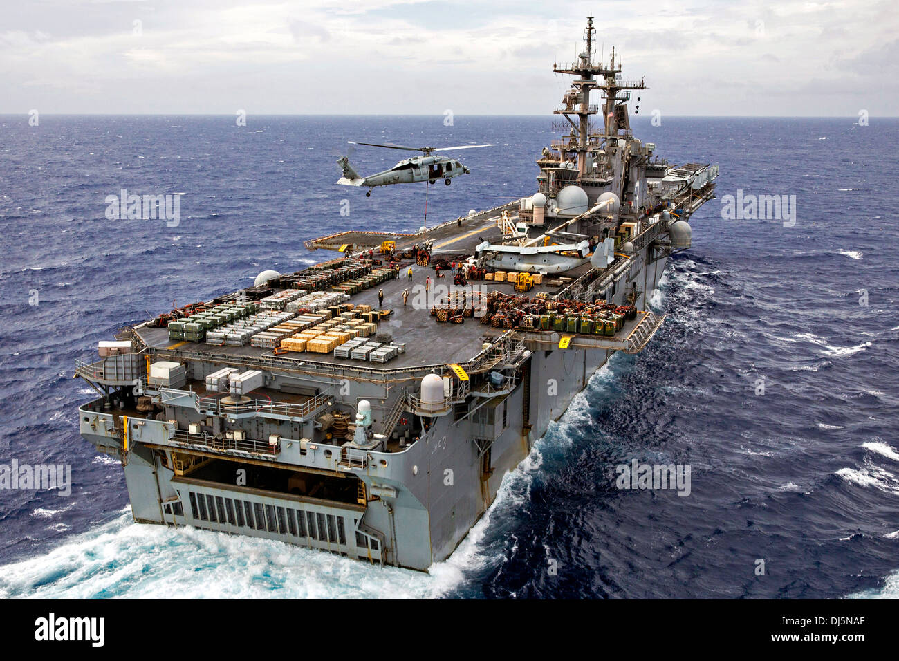 The US Navy amphibious assault ship USS Kearsarge conducts an ammunition offload October 30, 2013 in the Atlantic Stock Photo