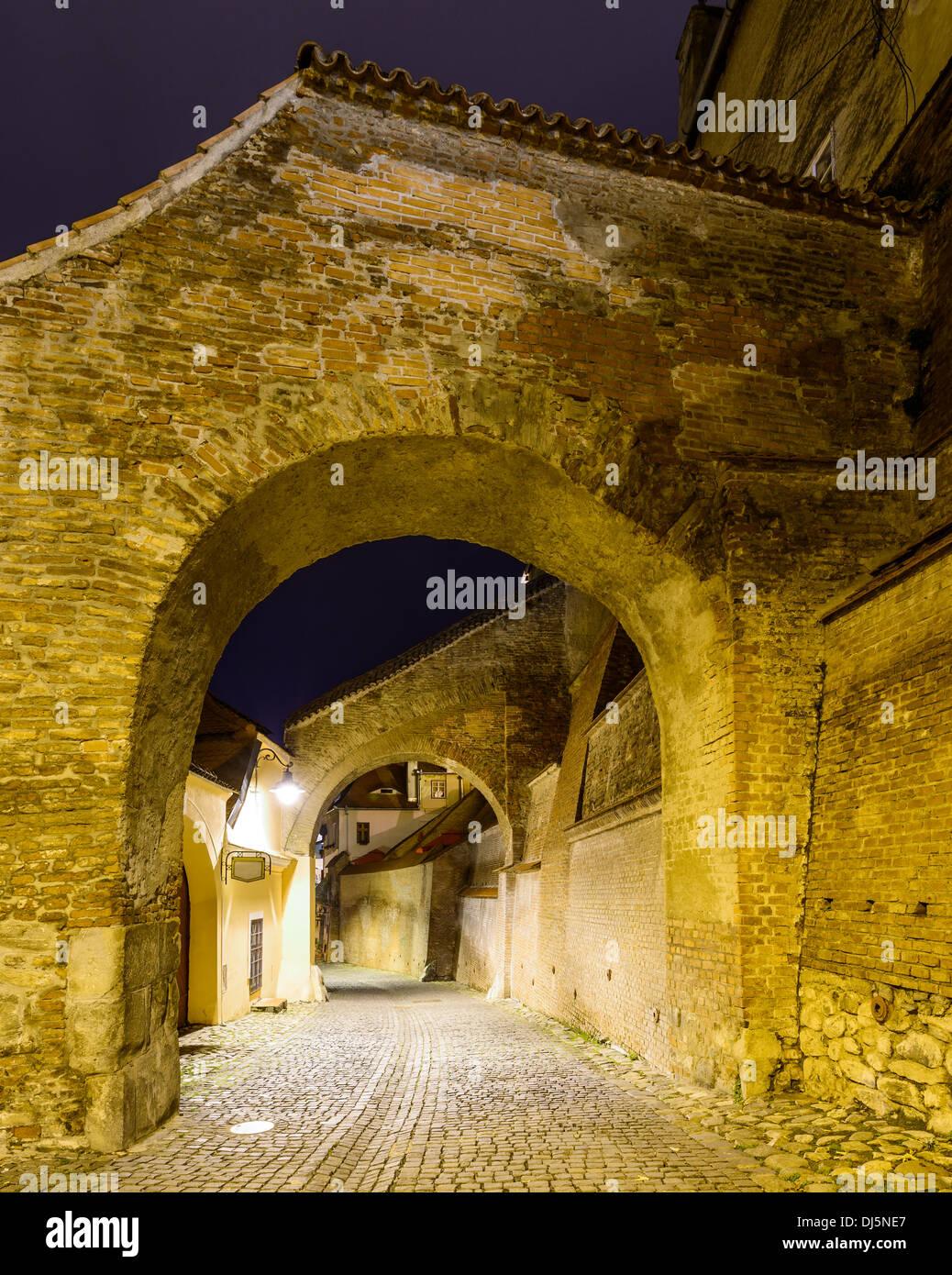 stairs passage in sibiu (hermannstadt), transylvania, romania, at night - Stock Image