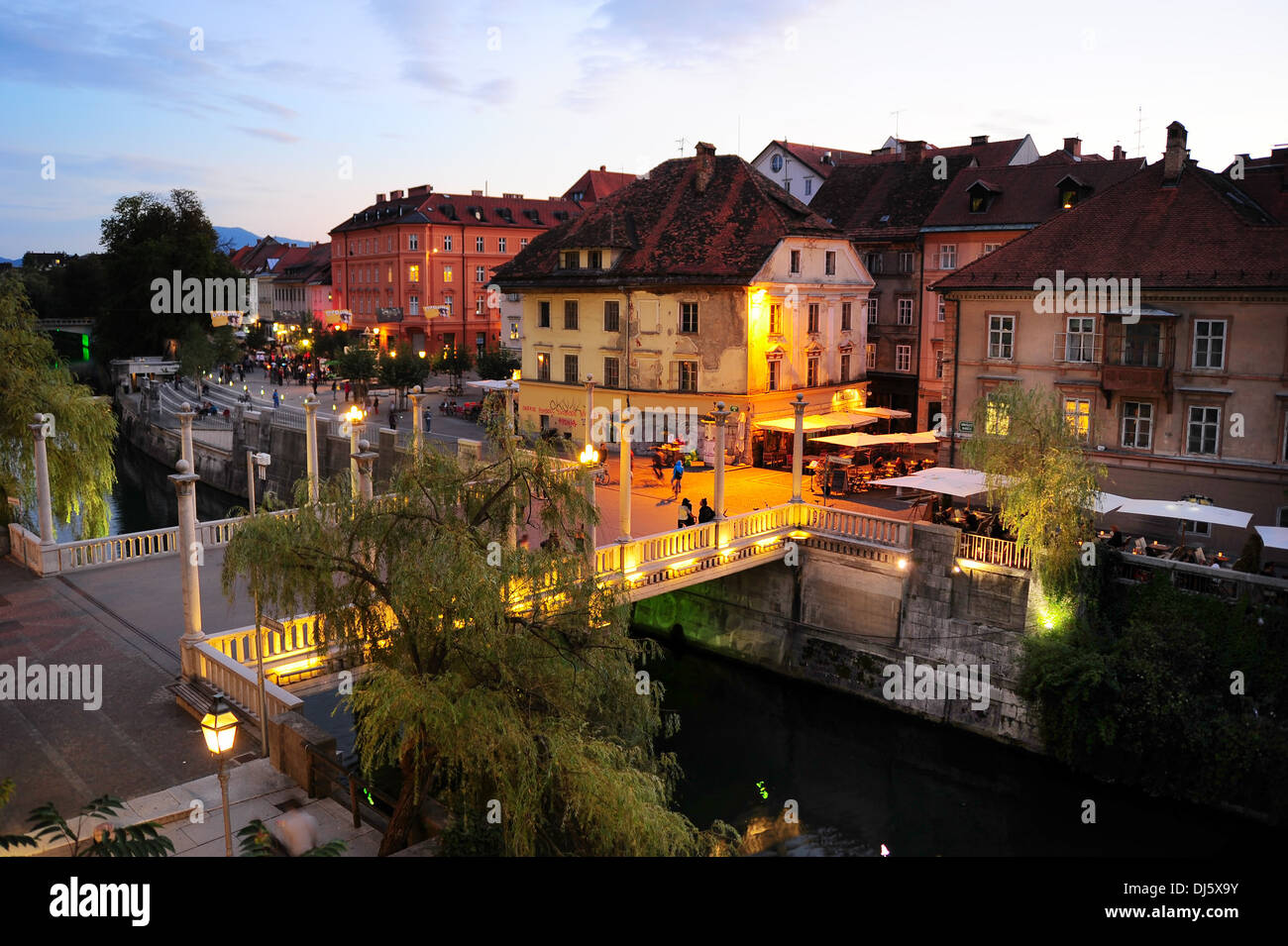 People walking at old town embankment in Ljubljana. - Stock Image