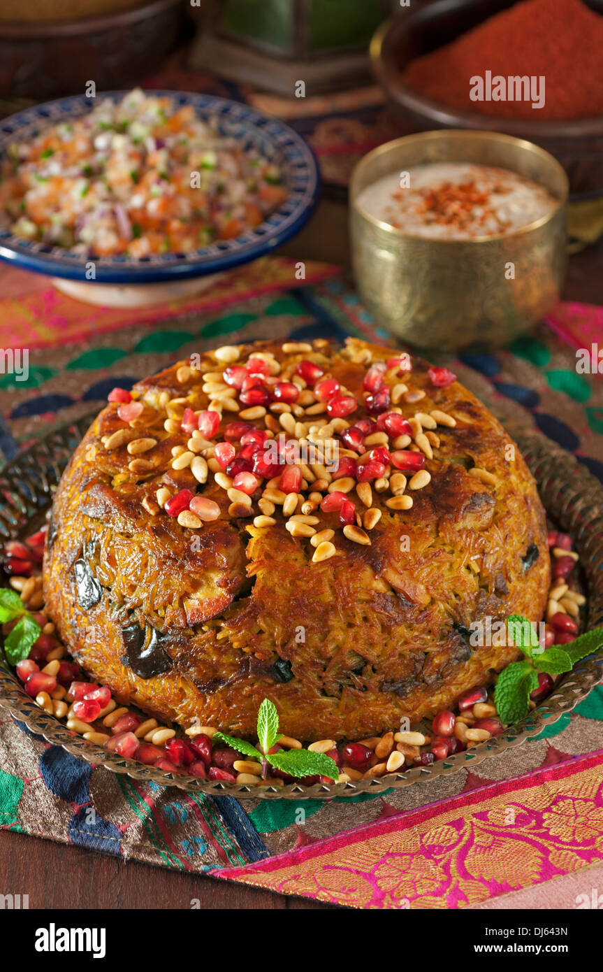 Palestinian dish stock photos palestinian dish stock images alamy chicken maqlooba upside down chicken and rice dish middle east food stock image forumfinder Choice Image