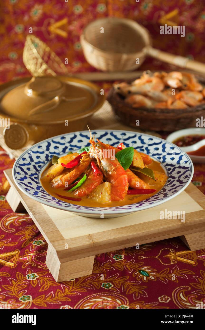 Thai prawn and pineapple curry. Kaeng Kua Sapparot. Food Thailand Stock Photo