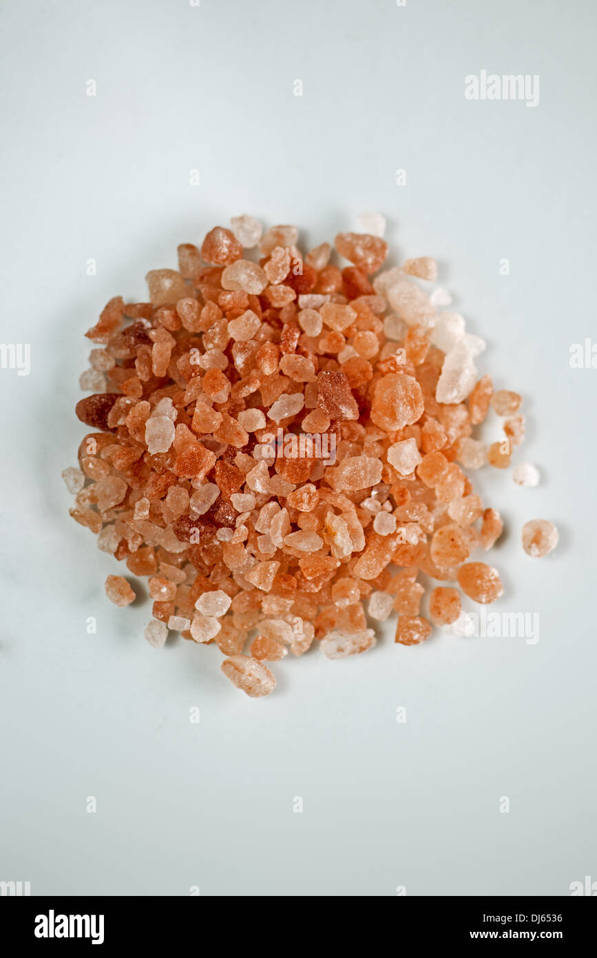 Himalayan pink salt on white background. Stock Photo