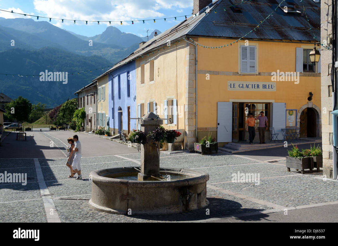 Tourists Walk Along the Main Street Mont-Dauphin Hautes-Alpes France - Stock Image