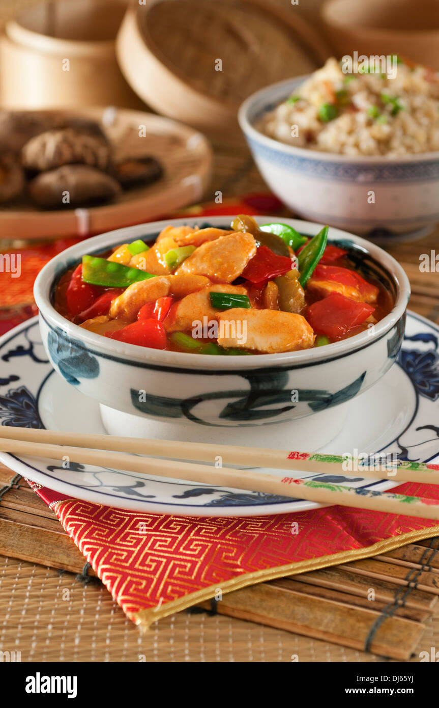 Sweet and sour chicken with egg fried rice. Chinese food. - Stock Image