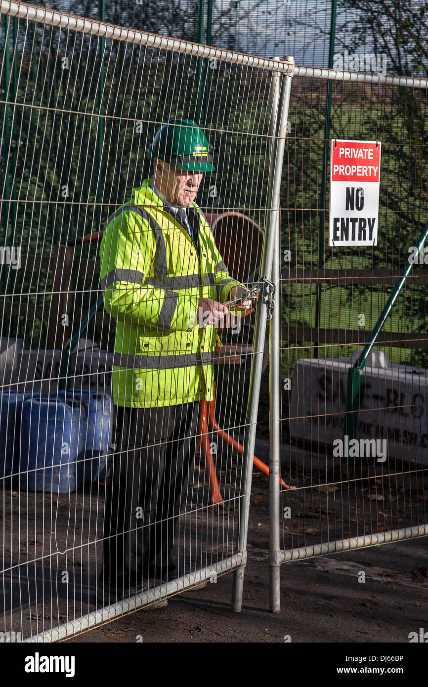 Barton Moss, Eccles, Manchester, UK. 22nd November, 2013.  'No entry' Security gates at  IGas Energy Drill site at Barton Moss in Salford, Manchester. Fracking focus is shifting to North West where IGas Energy plans to start drilling soon to explore for methane. A small number of Anti-fracking anti-shale gas group protesters have pitched tents and set up camp near the planned gas-drilling site in Salford. IGas has permission from Salford for exploratory drilling, and from Trafford council for coal-bed methane extraction at an adjoining site at Davyhulme. Credit:  Mar Photographics/Alamy Live N - Stock Image