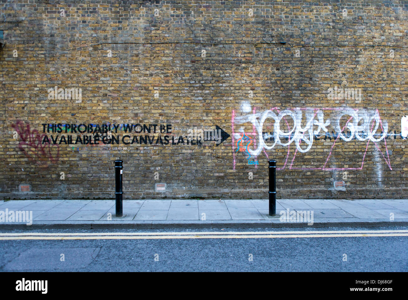 'This Probably Won't Be Available on Canvas Later' stencil graffiti, Hanbury Street, Tower Hamlets, London E1, UK. - Stock Image