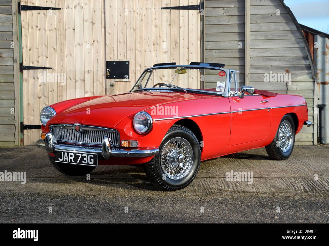 Red chrome bumper MGB convertible classic British sports car - Stock Image