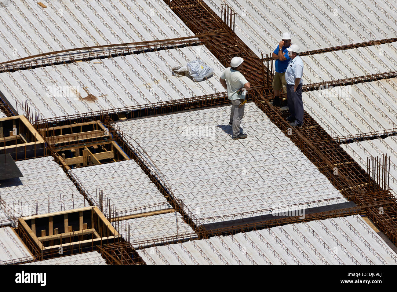 Inspection of a precast reinforced concrete ceiling - Stock Image