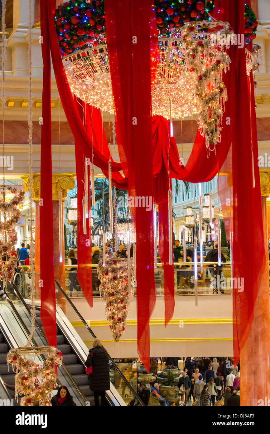 Christmas shoppers in the Trafford Centre in Manchester, UK. - Stock Image