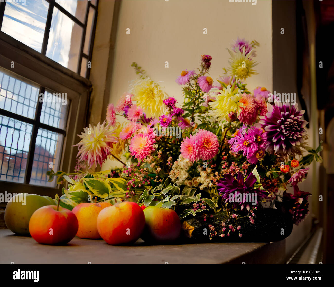 Flowers and apples in Molton Church. - Stock Image