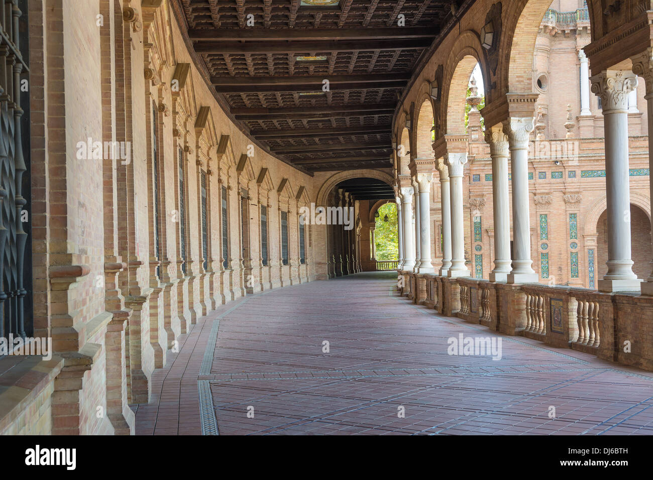 Plaza de Espana in the center of Seville, Spain a major tourist attraction showing the cloister. - Stock Image