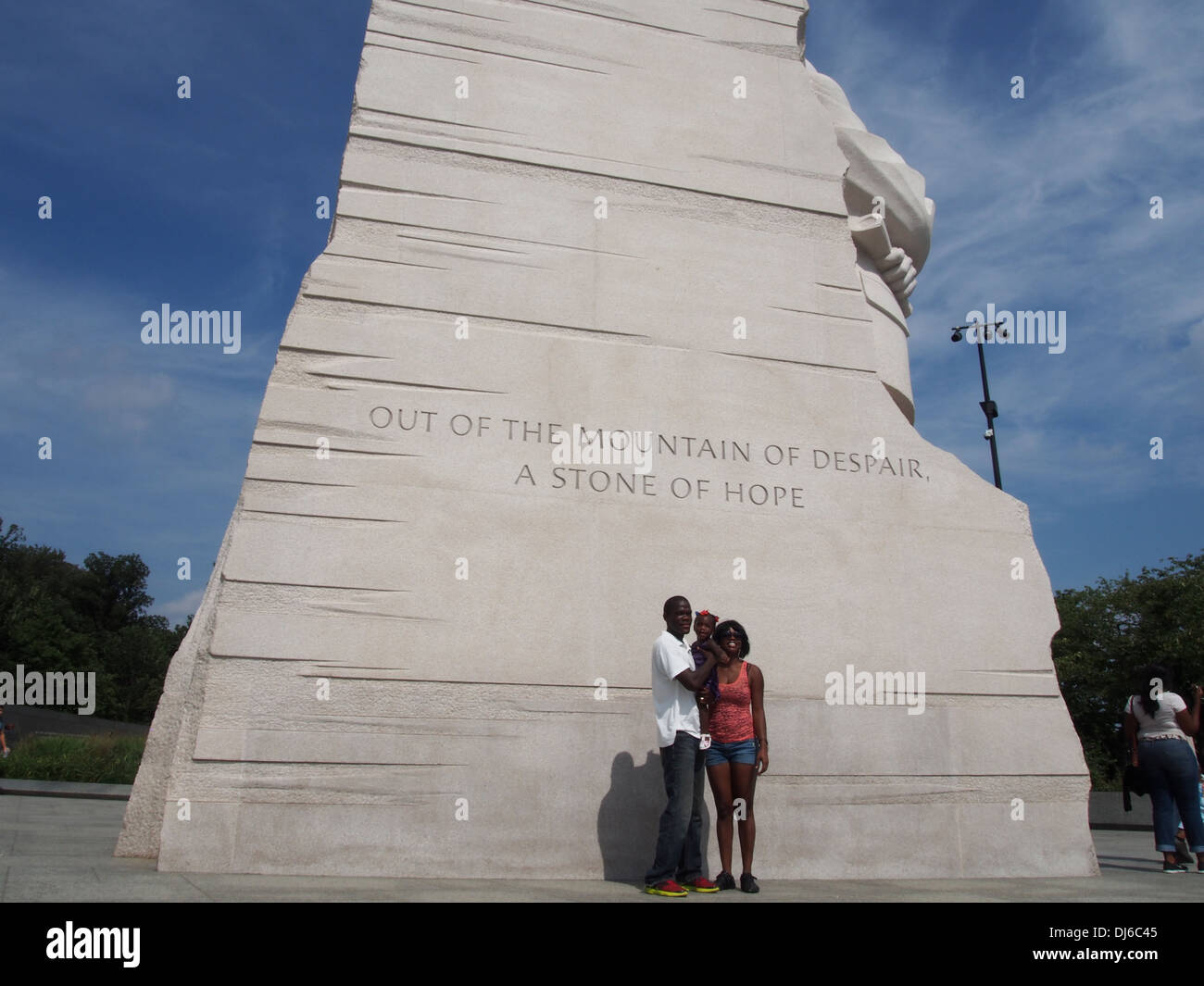 An African-American couple and their child pose for a photo at the Martin Luther King Jr. Memorial in Washington, D.C., USA - Stock Image