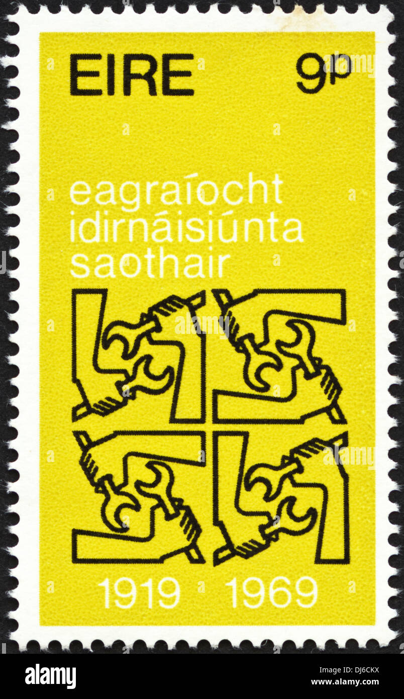 postage stamp Eire 9p featuring International Labour Organization 1919 - 1969 dated 1969 - Stock Image