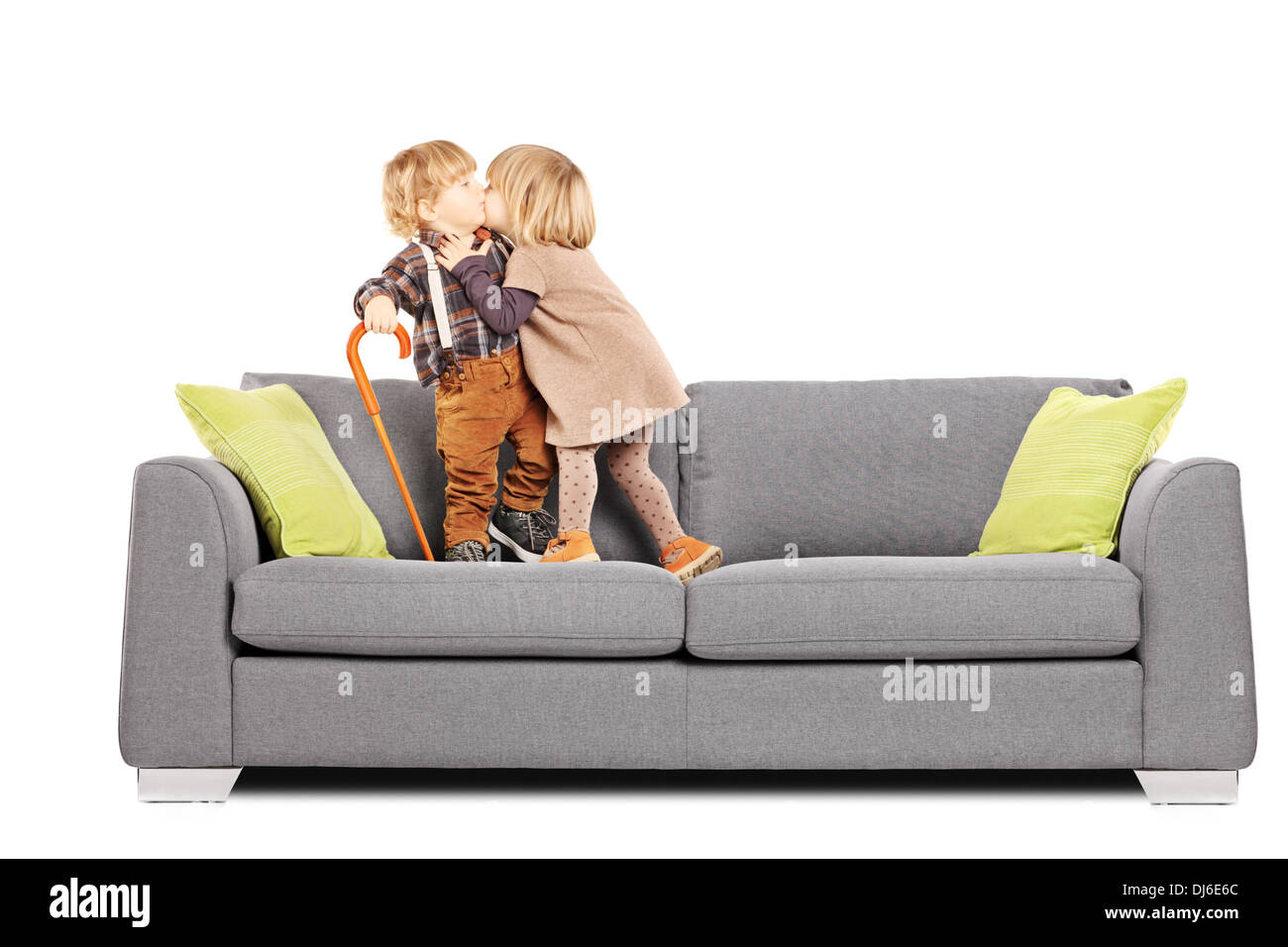 Two guys kissing on a sofa
