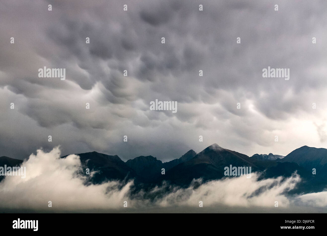 Stormy clouds over the mountains - Stock Image