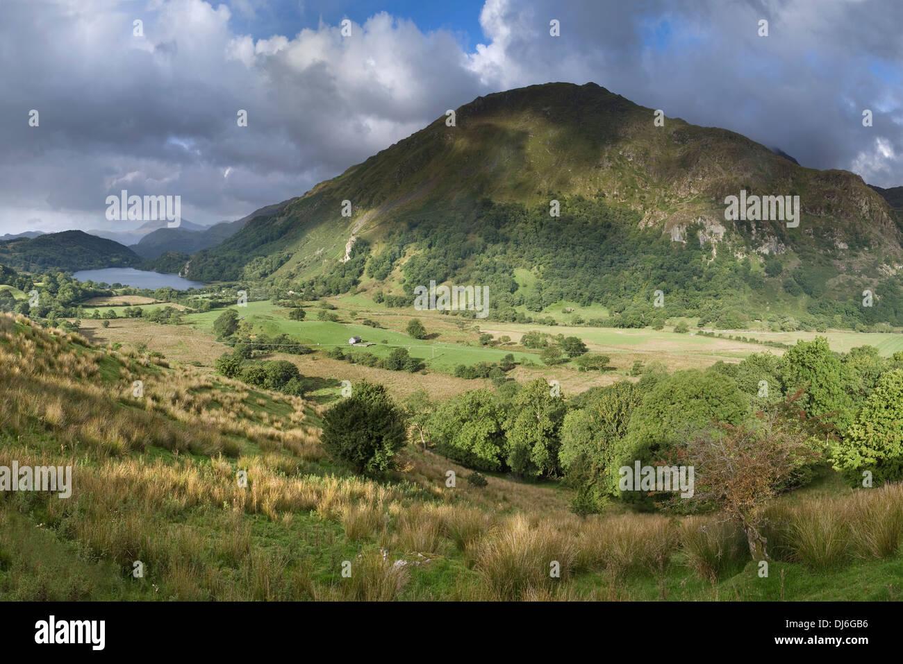 The clouds cast shadows over Gallt y Wenallt and Nant Gwynant towards Llyn Gwynant. Stock Photo