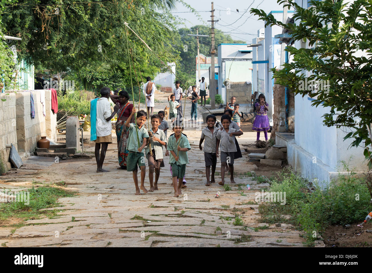 Rural indian school children playing in a village street. Andhra Pradesh, India - Stock Image