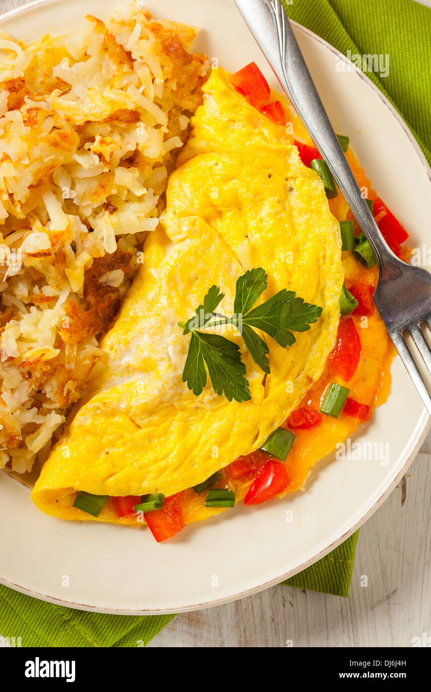 Homemade Organic Vegetarian Cheese Omelette with Onions and Peppers Stock Photo