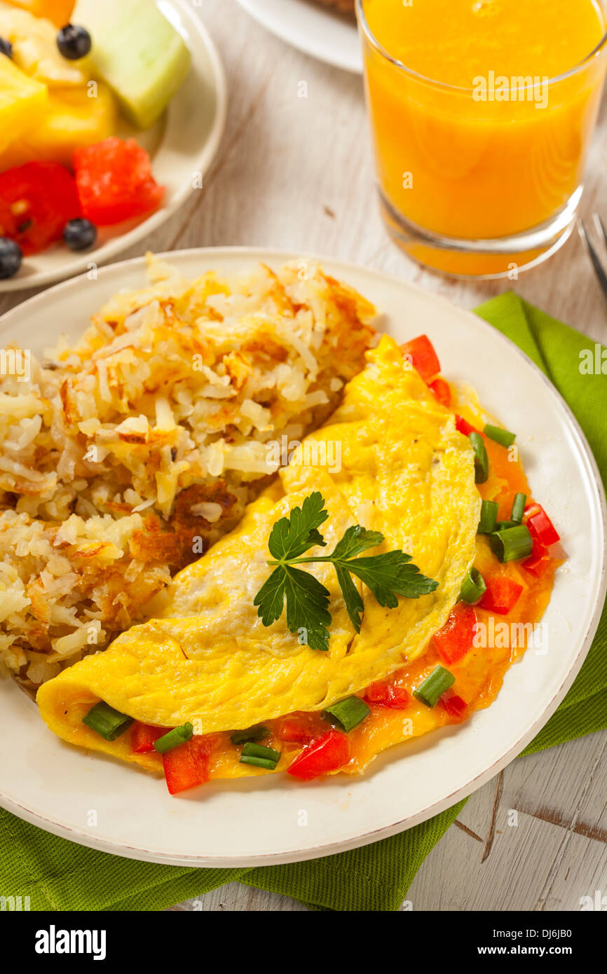 Homemade Organic Vegetarian Cheese Omelette with Onions and Peppers - Stock Image