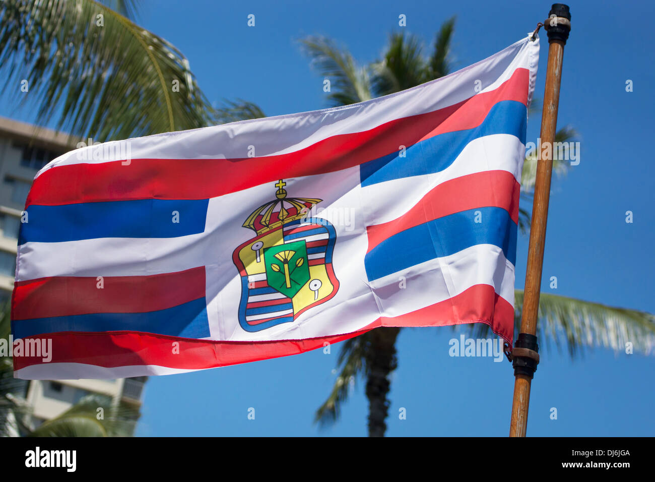 A Flag Flying With The Hawaiian Royal Seal; Oahu, Hawaii, United States Of America - Stock Image