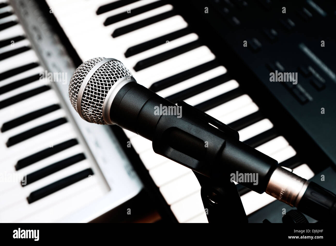 microphone and piano keyboards background Stock Photo