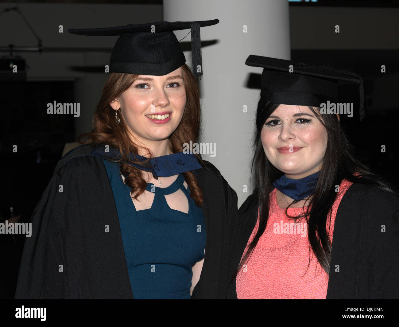 London England Young Women At their Graduation Ceremony Wearing Mortar Boards And Graduation Gowns - Stock Image