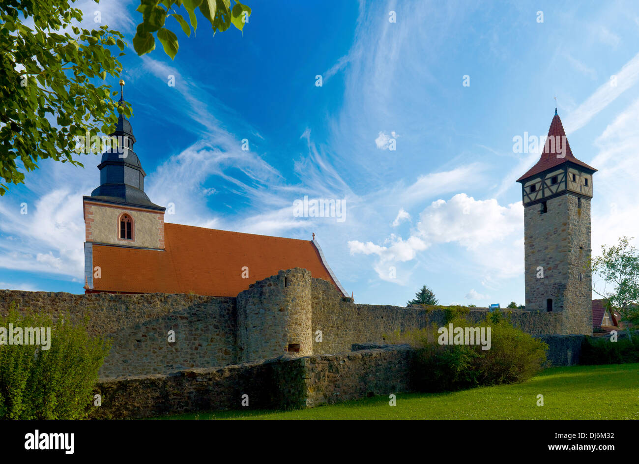 Fortified church in Ostheim, Rhoen Grabfeld district, Lower Franconia, Bavaria, Germany - Stock Image