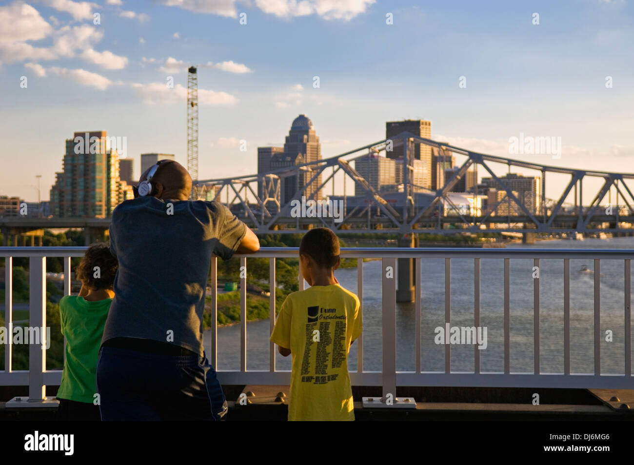 Father and Two Young Sons Looking Out Over the Ohio River and the City of Louisville from the Big Four Pedestrian Bridge - Stock Image