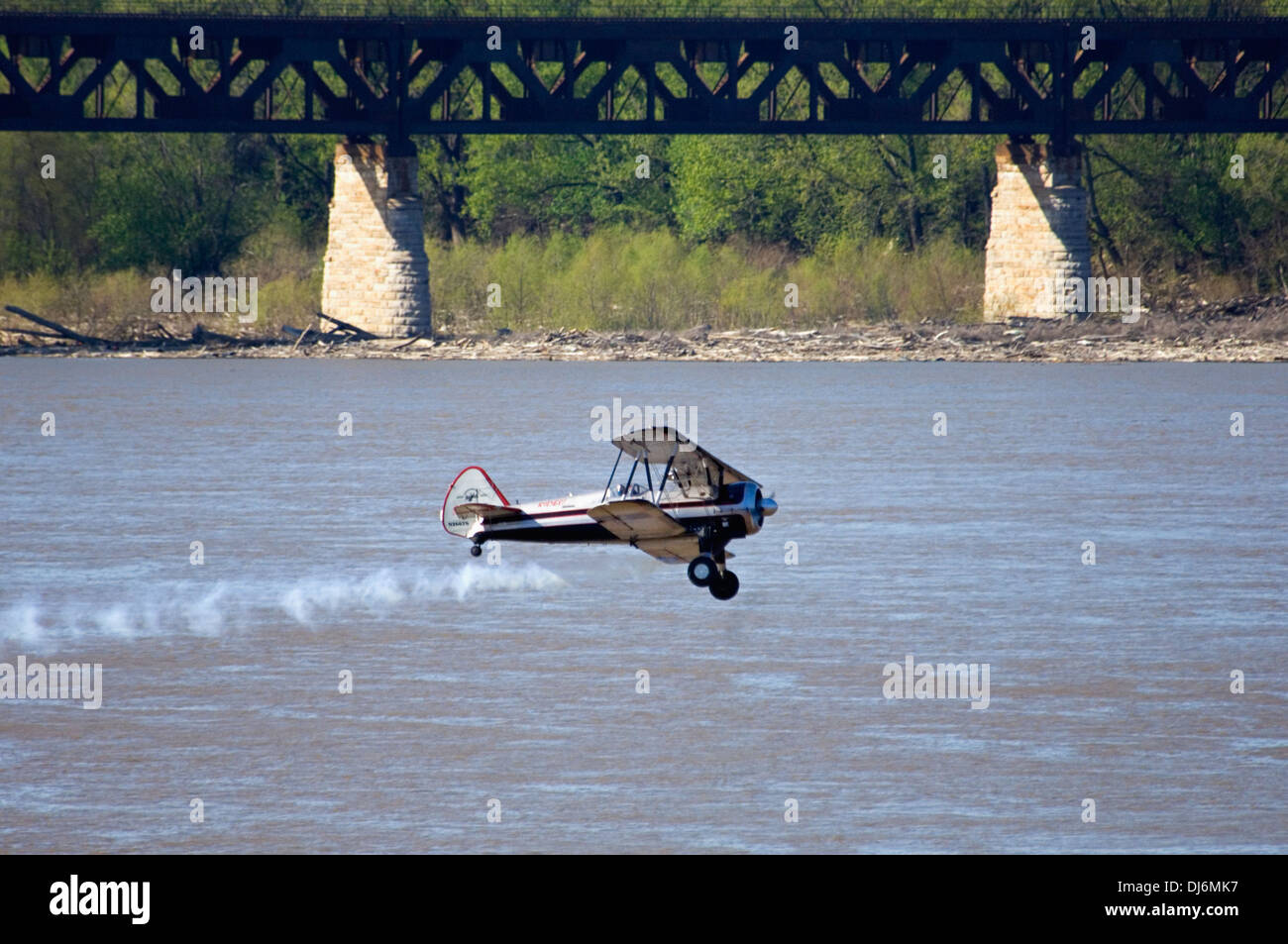 Biplane Flying Over the Ohio River during Thunder Over Louisville - Stock Image