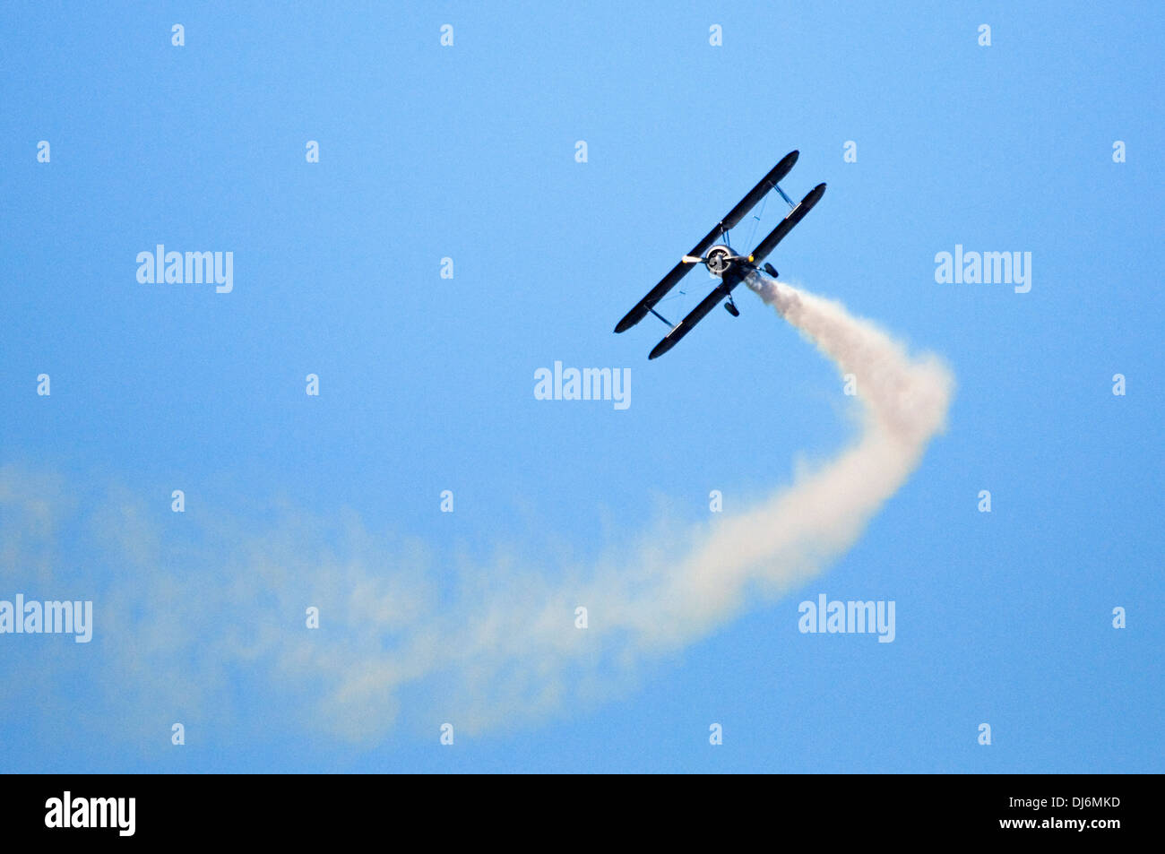 Biplane Performing during Thunder Over Louisville - Stock Image