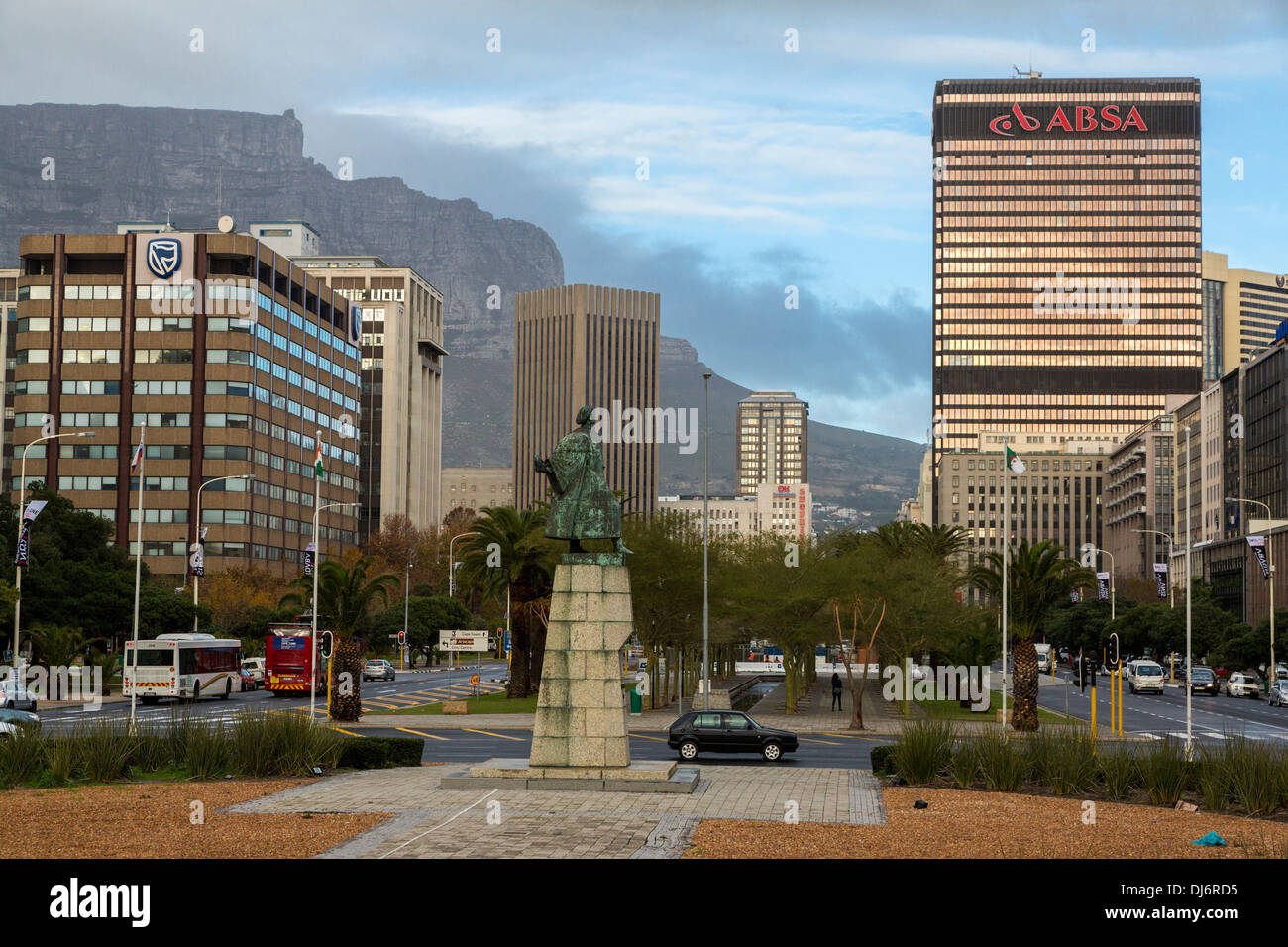 South Africa, Cape Town. Statue of Bartholomew Diaz in Traffic Circle. Adderley Street in Background. - Stock Image