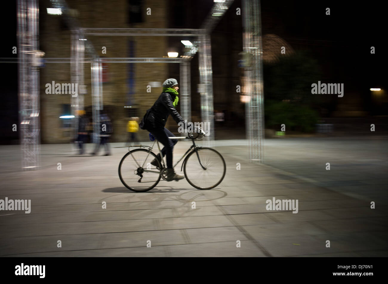 A woman cycling in Barcelona. - Stock Image