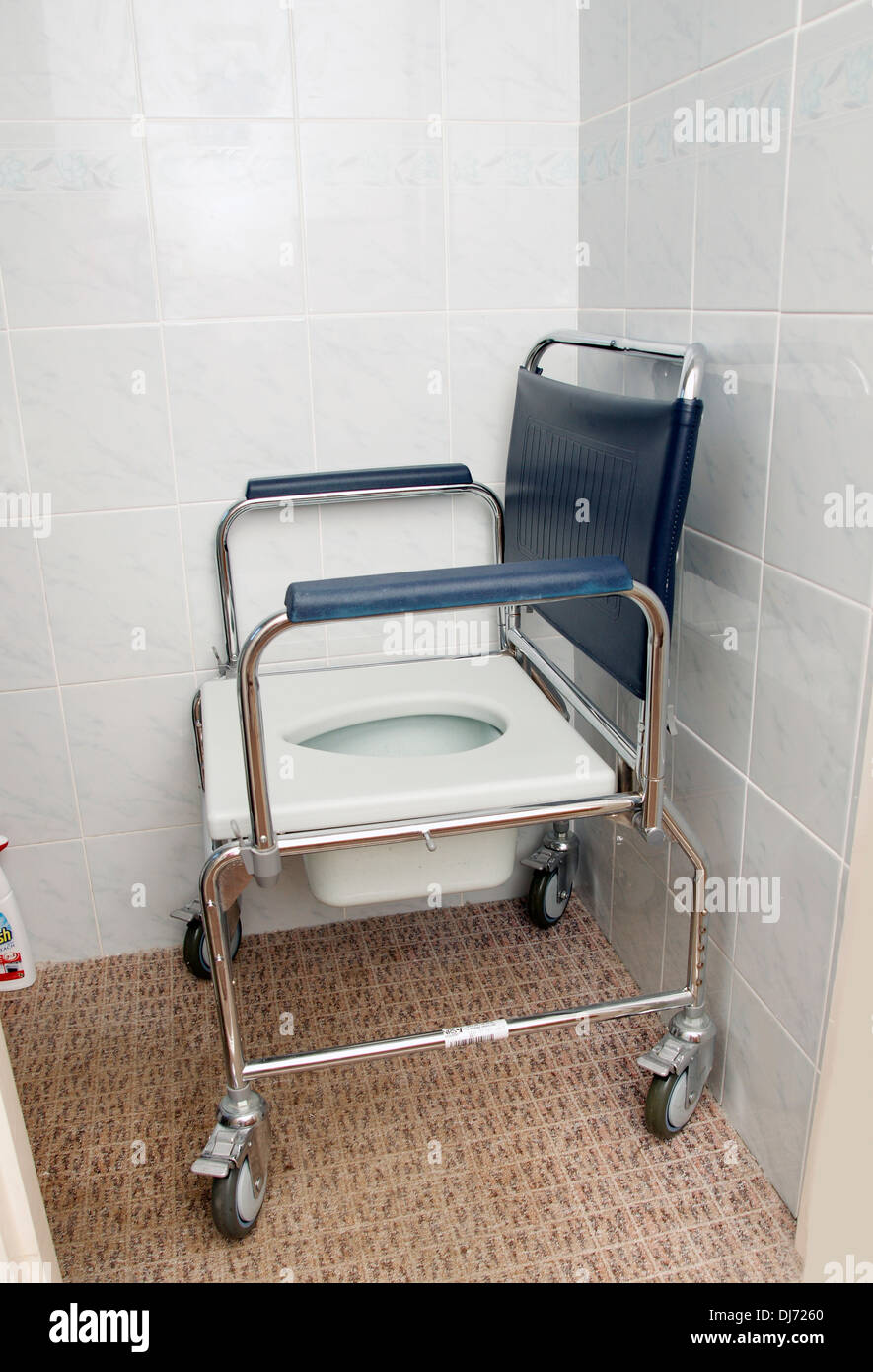 A Commode for a disabled person with wheels used for toileting & in ...
