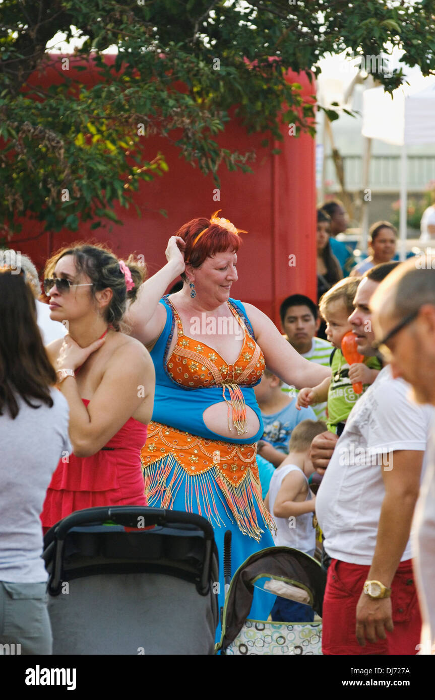 Overweight Belly Dancer in the Crowd at the 2013 Worldfest in Louisville, Kentucky - Stock Image