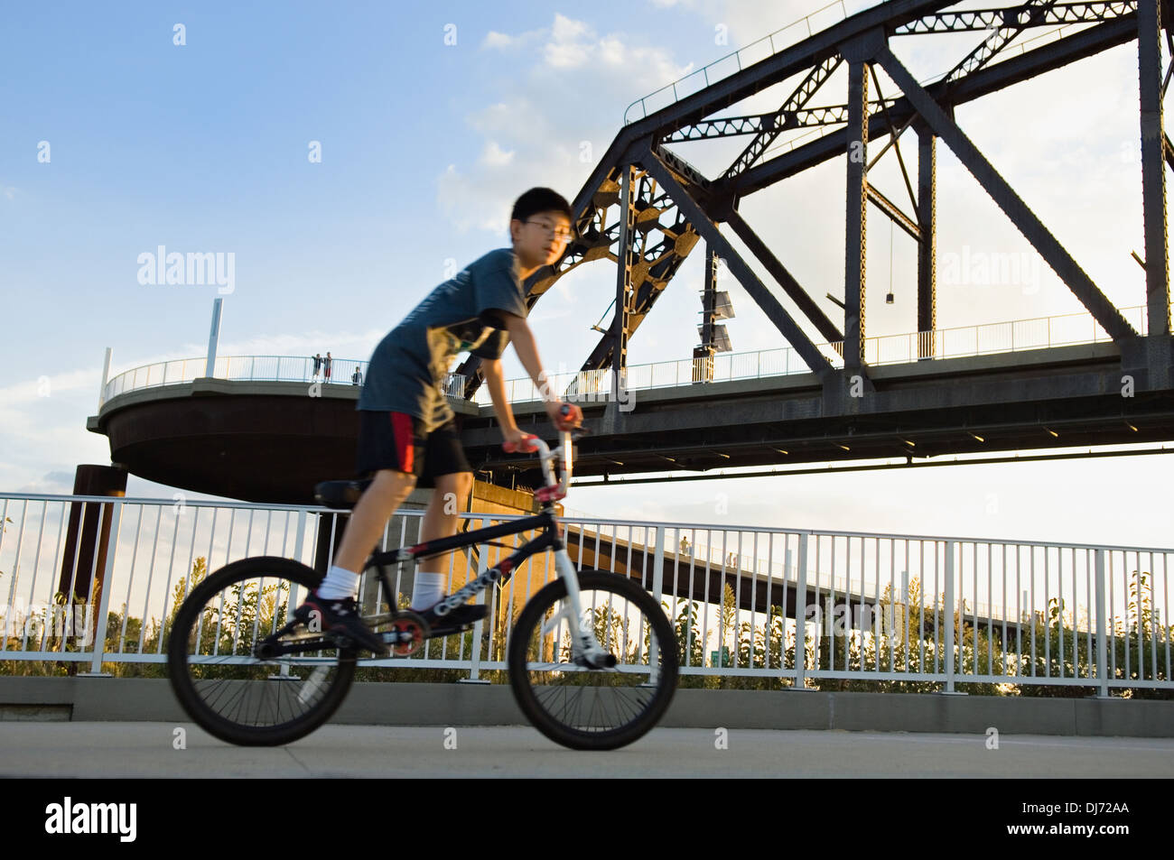 Boy Riding Bicycle up to the Big Four Pedestrian Bridge in Louisville - Stock Image