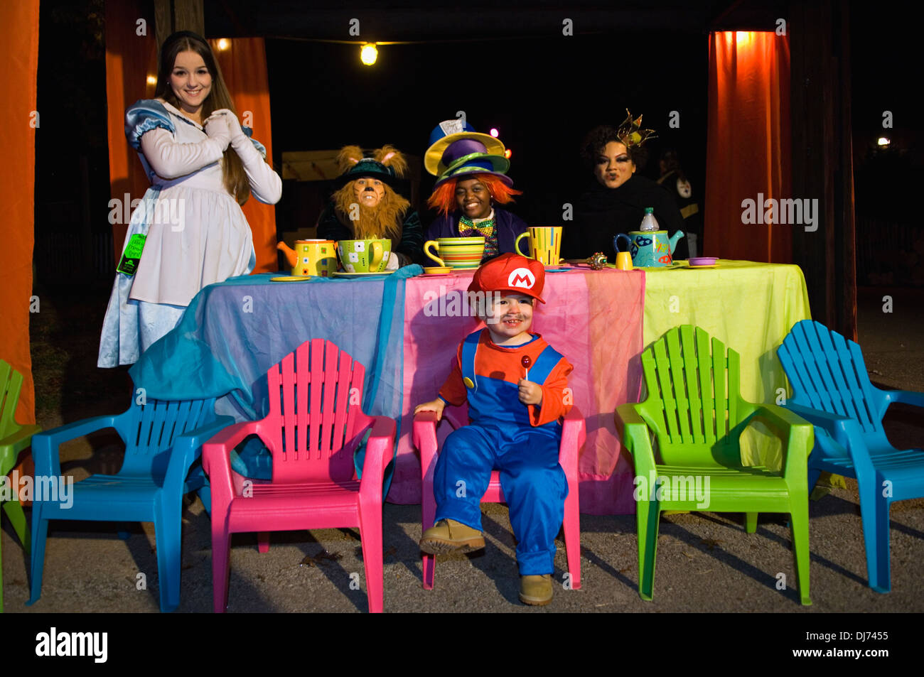 Toddler Dressed Up as Mario for Halloween with Charactors from Alice in Wonderland at the Louisville Zoo Halloween Party - Stock Image