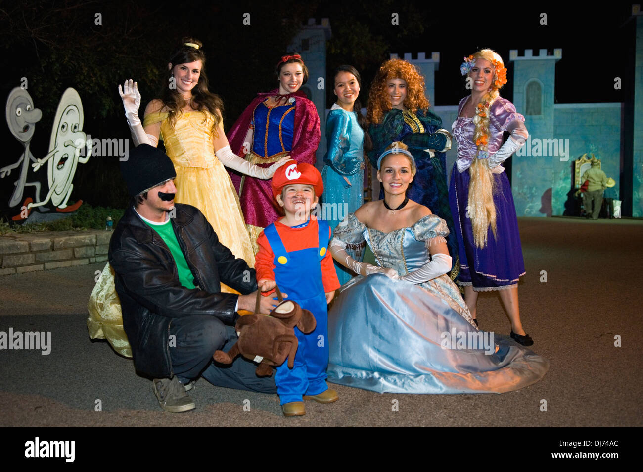 Toddler Dressed Up as Mario with his Father and Disney Princesses at the Louisville Zoo Halloween Party in Louisville Kentucky - Stock Image